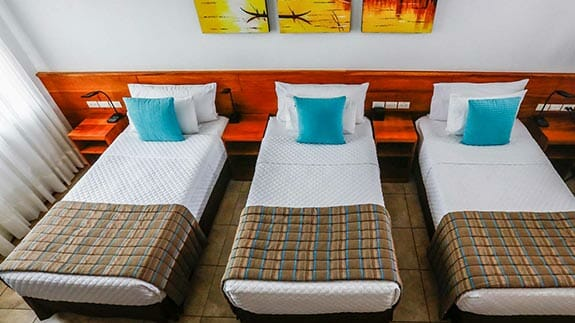 triple bed room at hotel cucuve suites puerto ayora, galapagos