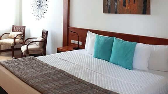 double bed room at hotel cucuve suites puerto ayora, sant cruz island, galapagos