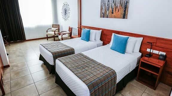 twin bed room at hotel cucuve suites puerto ayora, sant cruz island, galapagos