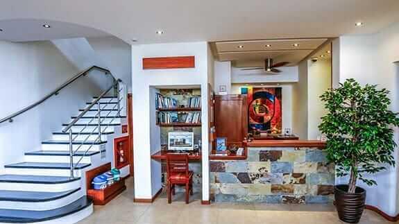 cucuve suites hotel reception area