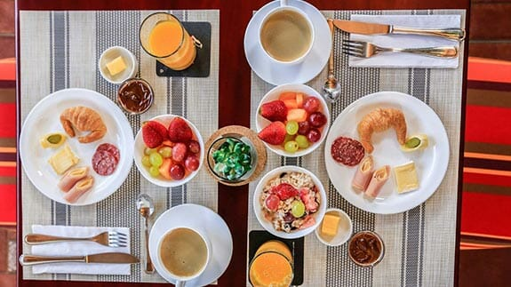 cucuve suites breakfast of fruit, bread and coffeegos