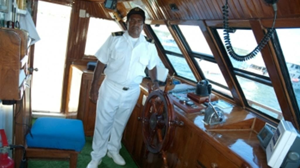 Darwin yacht galapagos cruise - captain at the wheel