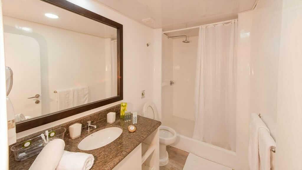 ecogalaxy II catamaran galapagos cruise - guest shower, bathroom and wash basin