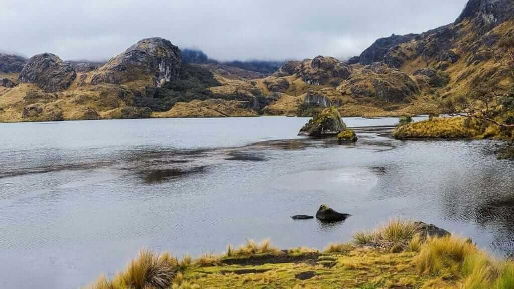 pretty glacial lake and hills of el cajas national park ecuador