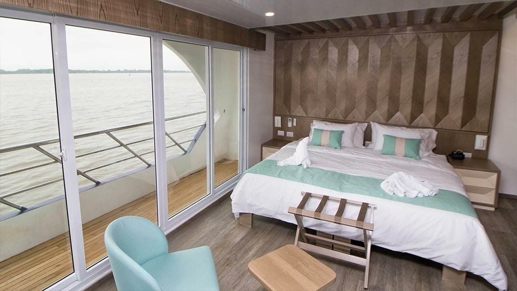 Endemic Yacht Galapagos Cruise - large double bed guest cabin with private balcony