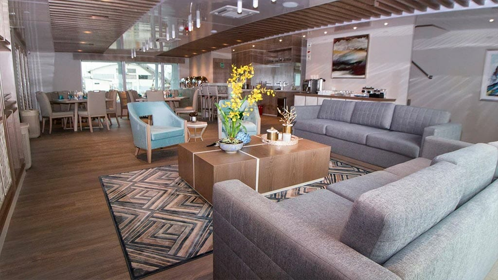 Endemic Yacht Galapagos Cruise - social area with sofas and flowers