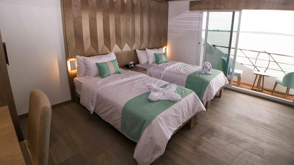 Endemic Yacht Galapagos Cruise - large twin bed guest cabin with private balcony
