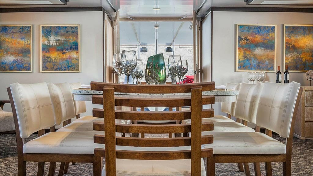 Evolution cruise ship Galapagos Islands - dining table with wine glasses