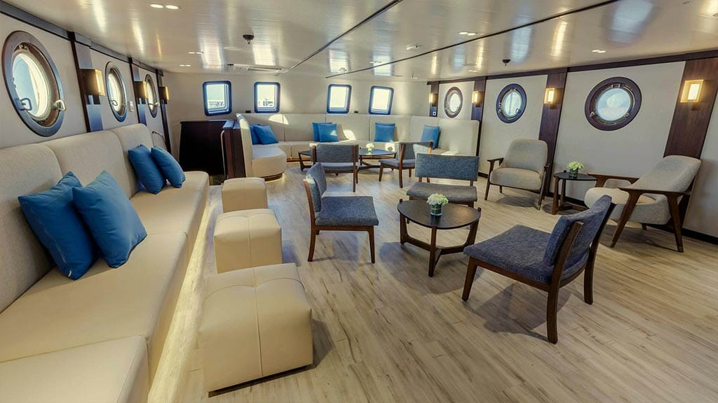 Evolution cruise ship Galapagos Islands - social lounge area with portholes