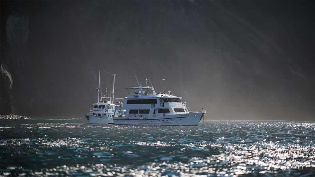 Fragata Yacht Galapagos cruise - side view of the Fragata cruising alongside the Golondrina yacht