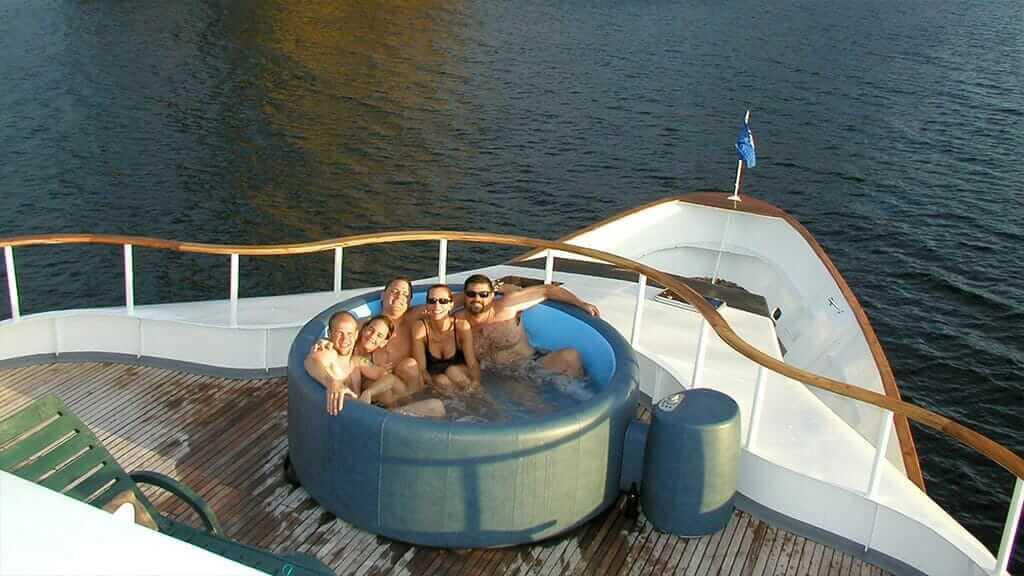 Aggressor III dive yacht Galapagos cruise - tourists enjoying the jacuzzi