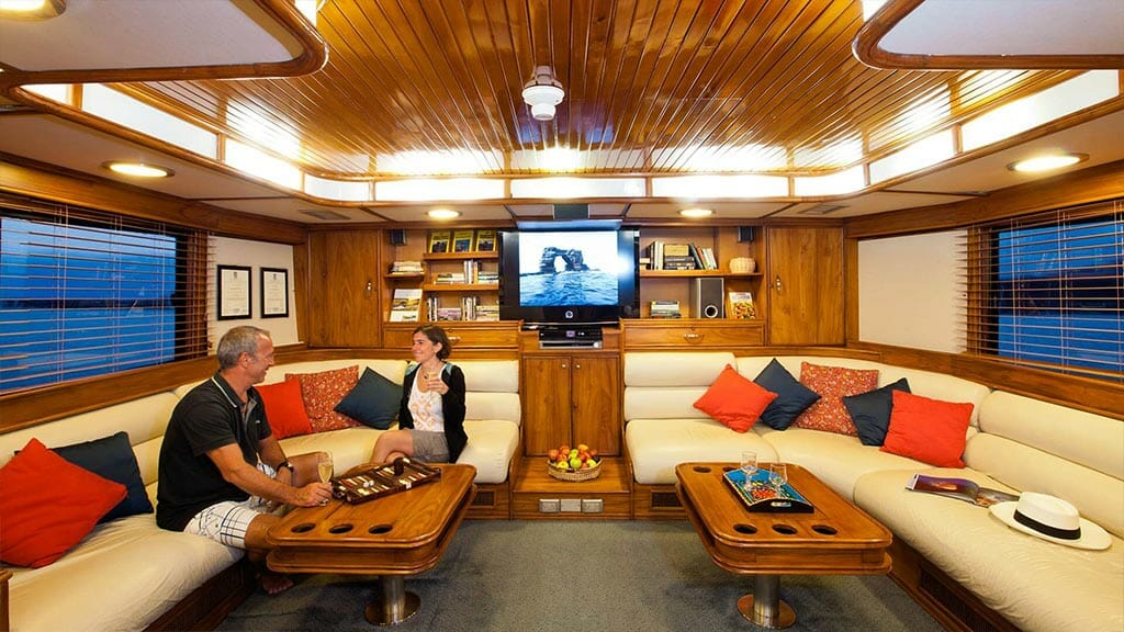 Aggressor III dive yacht Galapagos cruise - social lounge area with board games and tv