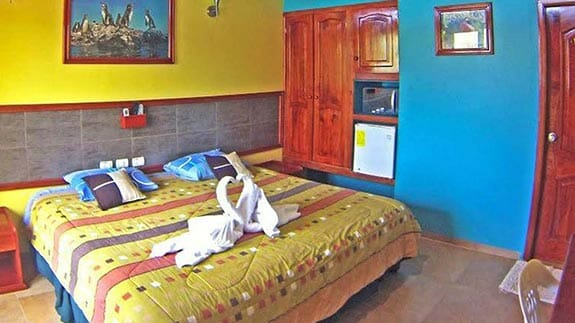 galapagos eco friendly hotel - colorful guest bedroom