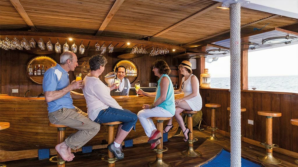 Legend cruise ship Galapagos Islands - fresh cocktails served to tourists at the bar