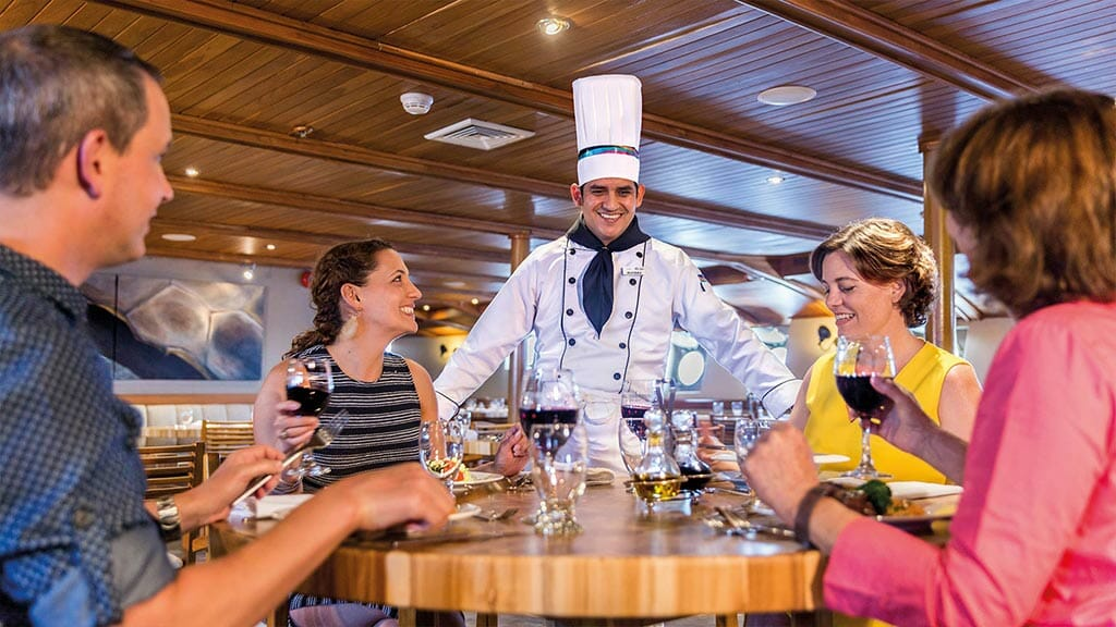 Legend cruise ship Galapagos Islands - chef greets tourists at dinner time