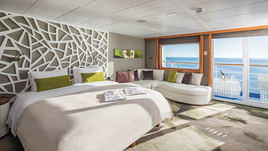Legend cruise ship Galapagos Islands - spacious suite with king bed, sofa and private balcony