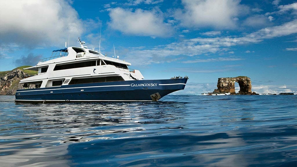 Galapagos Sky yacht liveaboard dive cruise - side view of yacht sailing past Darwins Arch