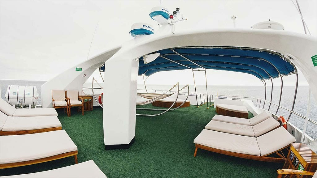 Galapagos Sky yacht liveaboard dive cruise - sundeck with loungers and optional shaded area