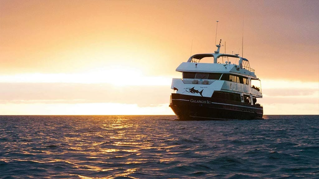 Galapagos Sky yacht liveaboard dive cruise - front view of yacht with sunset backdrop