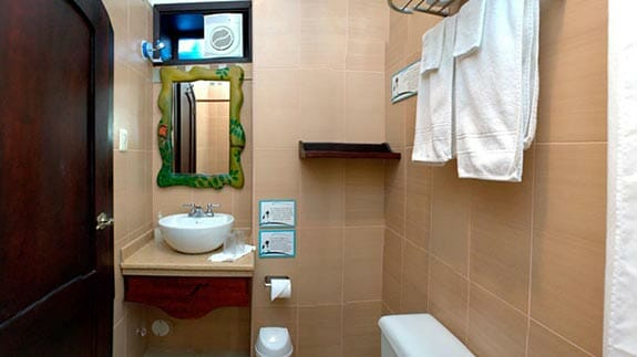 guest bathroom at Galapagos Suites Hotel