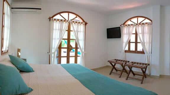 Hotel Galapagos Suites, Puerto Ayora, Santa Cruz, Galapagos – double bedroom with patio doors