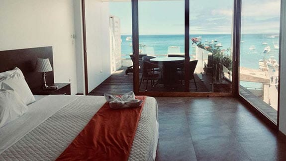 galapagos sunset hotel - double bedroom with balcony and sea view