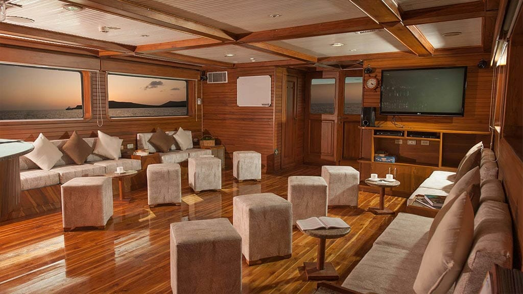 Galaxy yacht Galapagos cruise - indoor lounge social area with tv