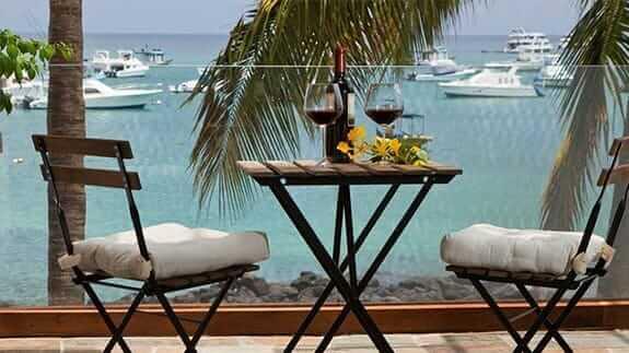 glasses of wine overlooking san cristobal harbor golden bay hotel galapagos