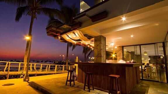 illuminated bar and muyu restaurant of golden bay hotel on baquerizo moreno malecon