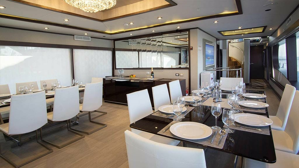 Grand Majestic yacht Galapagos islands - indoor dining tables laid out ready fro dinner