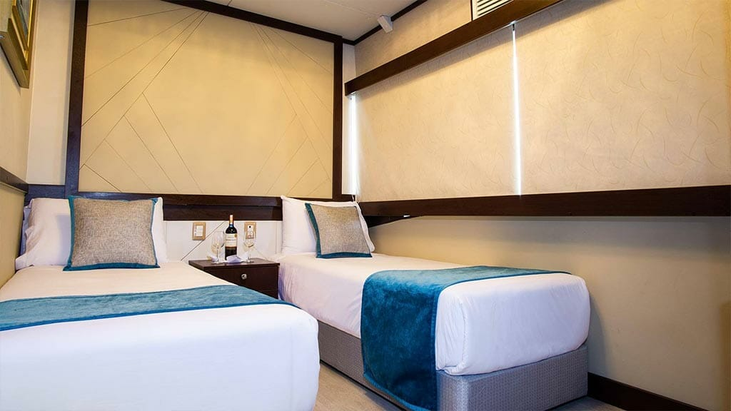 Twin bed cabin aboard the Grand Majestic yacht Galapagos cruise