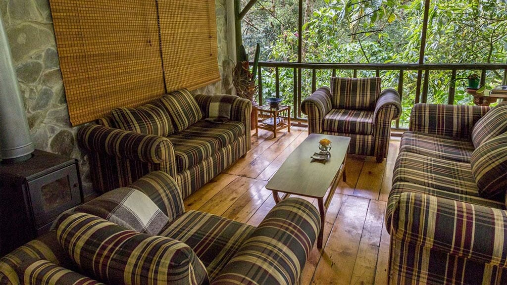 guango lodge ecuador - social area with chimney and cloud forest views