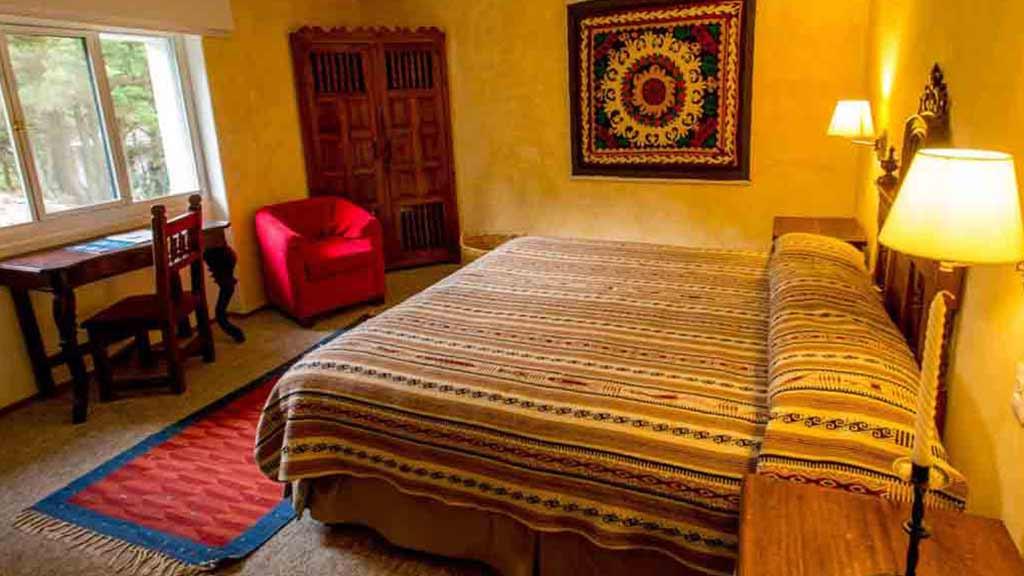 double guest bedroom at hacienda cusin otavalo ecuador