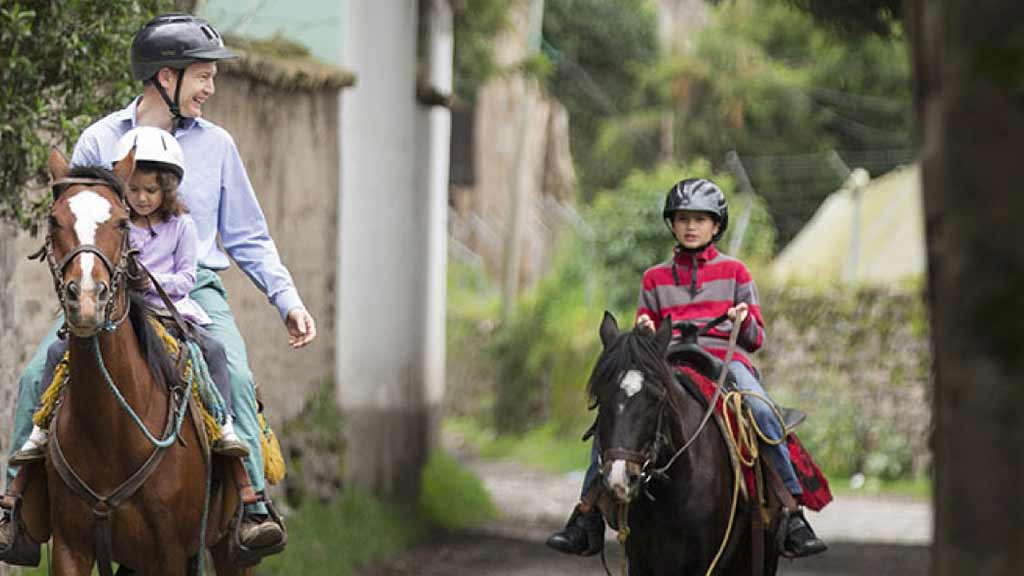 tourists enjoy horse riding at hacienda cusin otavalo ecuador