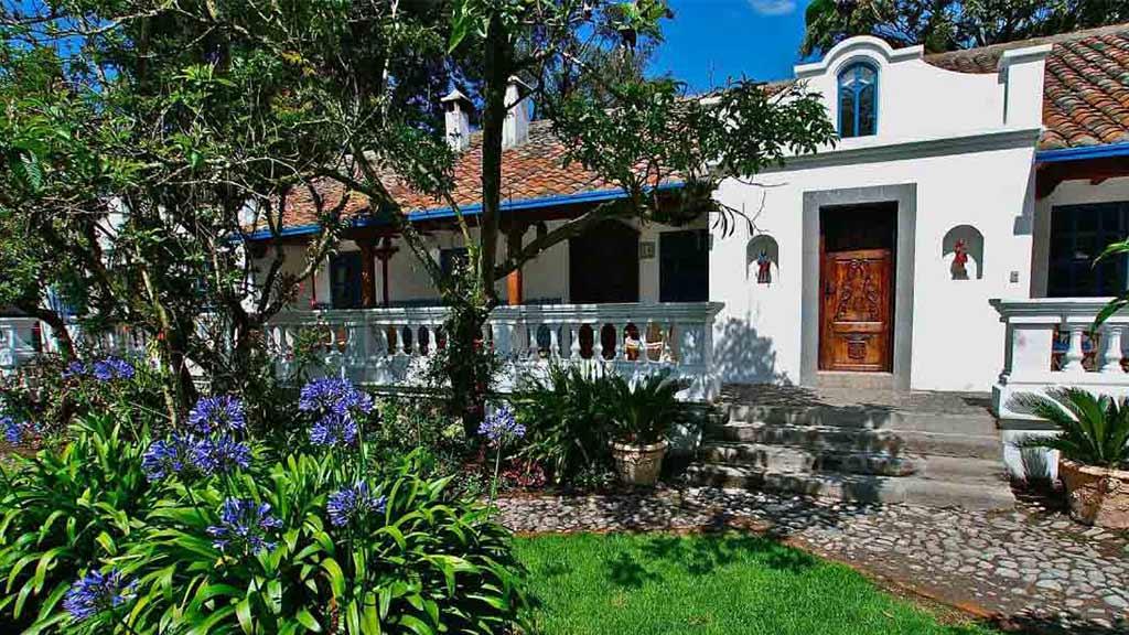 hacienda cusin rooms and flower garden
