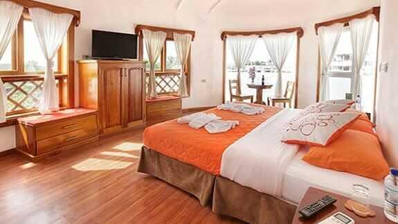 double room and sofa at Hotel Mainao, Puerto Ayora Galapagos