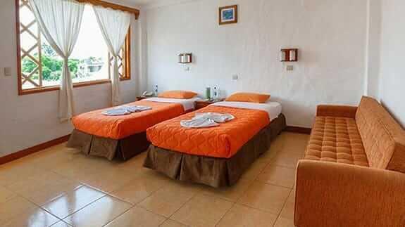 twin room and sofa at Hotel Mainao, Puerto Ayora Galapagos