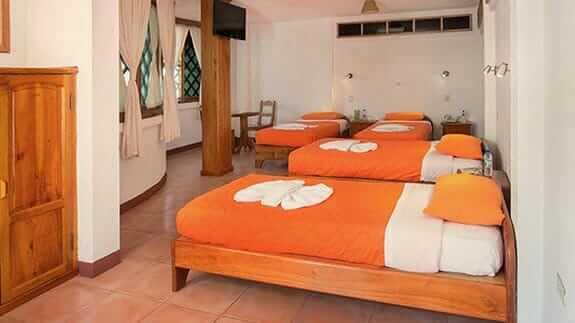 cuadruple room and sofa at Hotel Mainao, Puerto Ayora Galapagos