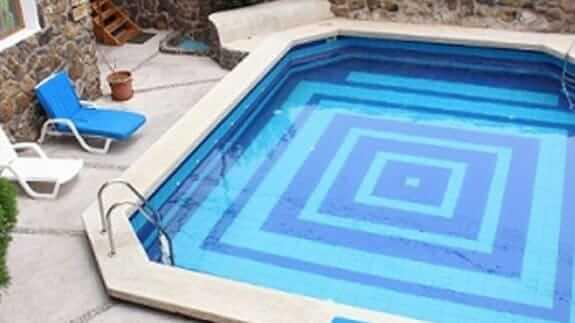 outdoor swimming pool at hotel pimampiro, baquerizo moreno town san cristobal galapagos