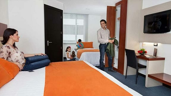tourists relax together with kids in family room at hotel finlandia in quito ecuador