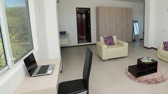 Large guest room and writing desk at hotel miconia baquerizo moreno galapagos