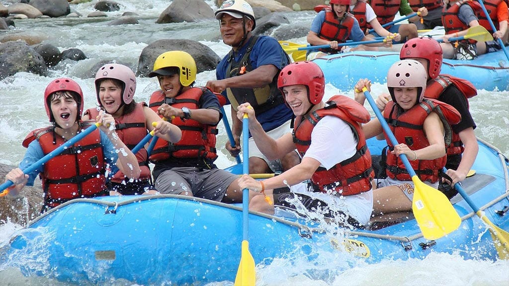 tourists white water rafting at Huasquila jungle Lodge Ecuador