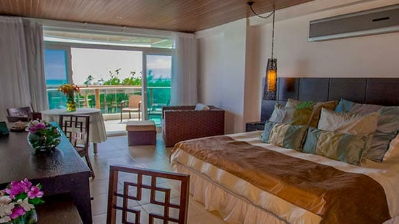 king bed room with private balcony at Iguana Crossing Hotel, Puerto Villamil, Isabela, Galapagos islands
