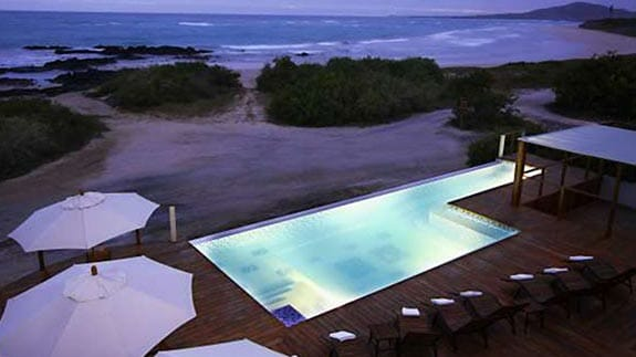 illuminated pool in front of the beach at the Iguana Crossing Hotel, Puerto Villamil, Isabela, Galapagos islands