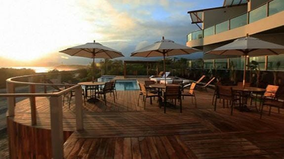 al fresco dining and decked pool area at the Iguana Crossing Hotel, Puerto Villamil, Isabela, Galapagos islands
