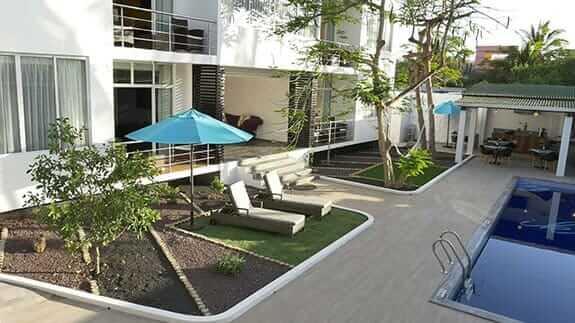 poolside sun loungers at ikala hotel puerto ayora galapagos