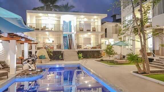 Hotel ikala and swimming pool illuminated at night at galapagos