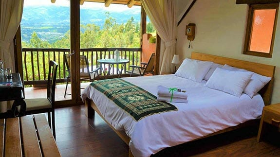 ilatoa lodge quito airport hotel - double bedroom with balcony and views