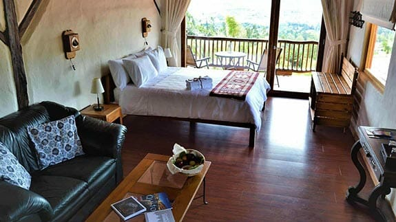 ilatoa lodge quito airport hotel - double bedroom with balcony and views and sofa