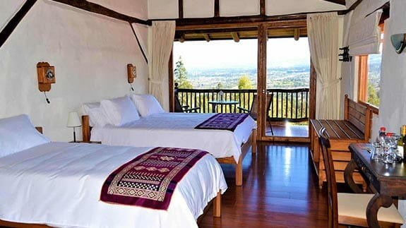 ilatoa lodge quito airport hotel - twin bedroom with balcony and views